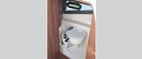 Optional enclosed sea toilet with window